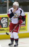 Landon Ferraro skates back to the bench during a stop in play in a Grand Rapids Griffins game.