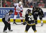 Brennan Evans of the Grand Rapids Griffins lines up for a faceoff across from Alex Chiasson of the Texas Stars, with Cody Eakin taking the draw for Texas.