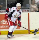 Brennan Evans turns in the corner to follow the puck out of the defensive zone in a Grand Rapids Griffins game.