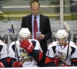 Grand Rapids head coach Jeff Blashill stands behind Louis-Marc Aubry and Tomas Jurco on the Griffins' bench.