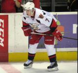 Brendan Smith gets set for a faceoff during a Grand Rapids Griffins game.