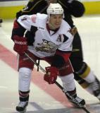 Nathan Paetsch fends off an opposing forward on a faceoff in a game between the Grand Rapids Griffins and the Texas Stars.