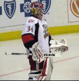 Petr Mrazek stands at the edge of his crease during a stop in play in a Grand Rapids Griffins game.