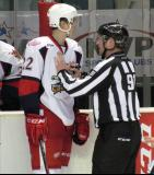 Louis-Marc Aubry is restrained by an official during a stop in play in a Grand Rapids Griffins game.