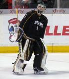 Texas Stars' goalie Jack Campbell skates outside his crease during a stop in play.