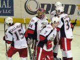 Mitch Callahan, Brendan Smith and Brian Lashoff celebrate with Petr Mrazek after the Grand Rapids Griffins defeat the Texas Stars.