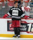 "Todd Bertuzzi stands along the boards during pre-game warmups prior to the ""Rock Out the Lockout"" charity game."