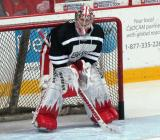 "Jimmy Howard crouches in the crease during pre-game warmups prior to the ""Rock Out the Lockout"" charity game."
