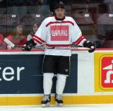 "Jamal Mayers stands along the boards during pre-game warmups prior to the ""Rock Out the Lockout"" charity game."