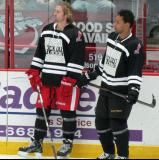"Darren Helm and Trevor Daley watch pre-game warmups prior to the ""Rock Out the Lockout"" charity game."