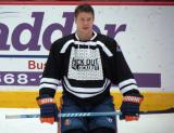 "Matt Martin kneels on the ice during pre-game warmups prior to the ""Rock Out the Lockout"" charity game."