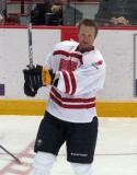 "Jordan Leopold flips a puck through the air during pre-game warmups prior to the ""Rock Out the Lockout"" charity game."