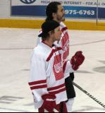 "Justin Abdelkader and Kevin Westgarth watch pre-game warmups prior to the ""Rock Out the Lockout"" charity game."