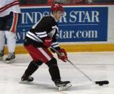 "Cory Emmerton carries the puck in the offensive zone during the ""Rock Out the Lockout"" charity game."