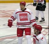 "Jonathan Ericsson waits for a faceoff during the ""Rock Out the Lockout"" charity game, with Niklas Kronwall nearby."