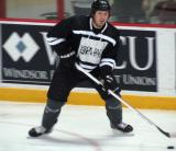 "Ryan Wilson carries the puck along the boards during the ""Rock Out the Lockout"" charity game."