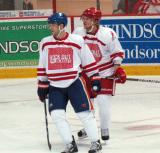 "Nick Schultz and Justin Abdelkader wait for a faceoff during the ""Rock Out the Lockout"" charity game."
