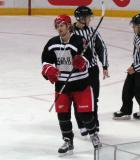"Darren Helm skates back to the bench during a stop in the ""Rock Out the Lockout"" charity game."