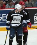 "John-Michael Liles and Danny Cleary wait for a faceoff during the ""Rock Out the Lockout"" charity game."