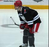 "Ian White gets set for a faceoff during the ""Rock Out the Lockout"" charity game."