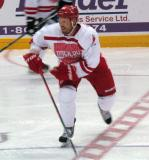 """Johan Franzen chases after the puck during the """"Rock Out the Lockout"""" charity game."""