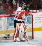 "Michael Leighton stands by the net during a stop in play  in the ""Rock Out the Lockout"" charity game."