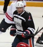 "Shawn Horcoff keeps his eyes on the puck during the ""Rock Out the Lockout"" charity game."