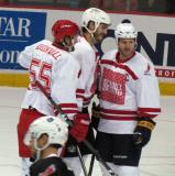 "Niklas Kronwall, Kevin Westgarth and Steve Ott celebrate a Team White goal during the ""Rock Out the Lockout"" charity game."
