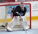 """Jonas Gustavsson takes to the net wearing an OHL practice jersey, having switched to Team Black for the third period of the """"Rock Out the Lockout"""" charity game."""
