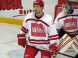 """Jonathan Ericsson sets up in front of goalie Michael Leighton during the """"Rock Out the Lockout"""" charity game."""
