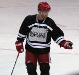 "Danny Cleary gives the puck back after a shootout attempt at the end of the ""Rock Out the Lockout"" charity game."