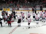 "The participants in the ""Rock Out the Lockout"" salute the fans in attendance at the end of the game."