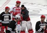 "Jonathan Ericsson and Jimmy Howard talk at center ice after a team photo from the ""Rock Out the Lockout"" charity game, as Darren Helm, James Neal and Ian White skate by."