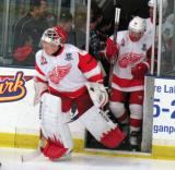 Chris Osgood and Kris Draper lead the Detroit Red Wings Alumni team onto the ice for a charity game at Compuware Arena.