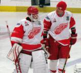 Chris Osgood and Darren McCarty talk while standing at the blue line during pre-game warmups before an alumni game.
