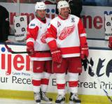 Dino Ciccarelli and Joe Kocur stand along the boards during pre-game warmups before an alumni game.