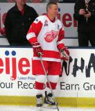 Igor Larionov stands along the boards during pre-game warmups before an alumni game.