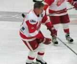Larry Murphy picks up the puck during pre-game warmups before an alumni game.