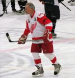 Mickey Redmond skates through the neutral zone during pre-game warmups before an alumni game.