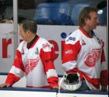 Ted Lindsay and Eddie Mio stand at the bench prior to the start of an alumni game.
