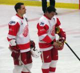 Jiri Fischer and Chris Chelios stand at the blue line after being introduced at the start of an alumni game.