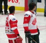 Chris Chelios and son Jake Chelios stand at the blue line after being introduced at the start of an alumni game.