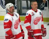 Joe Kocur and Igor Larionov stand at the blue line after being introduced before the start of an alumni game.