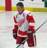 Larry Murphy skates to center ice for a faceoff in an alumni game.