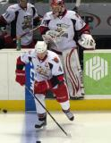 Nathan Paetsch and Petr Mrazek step onto the ice for pre-game warmups before a Grand Rapids Griffins game, with Andrej Nestrasil following them.
