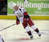 Triston Grant skates in the neutral zone during pre-game warmups before a Grand Rapids Griffins game.
