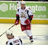 Nathan Paetsch skates in the neutral zone during pre-game warmups before a Grand Rapids Griffins game, with Brendan Smith nearby.