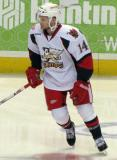 Chad Billins skates in the neutral zone during pre-game warmups before a Grand Rapids Griffins game.