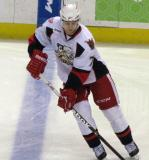 Brendan Smith picks up a puck at the blue line during pre-game warmups before a Grand Rapids Griffins game.
