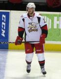 Landon Ferraro stands at the blue line during pre-game warmups before a Grand Rapids Griffins game.
